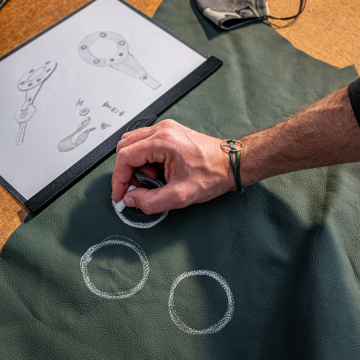 Drawing shapes on green upholstery leather